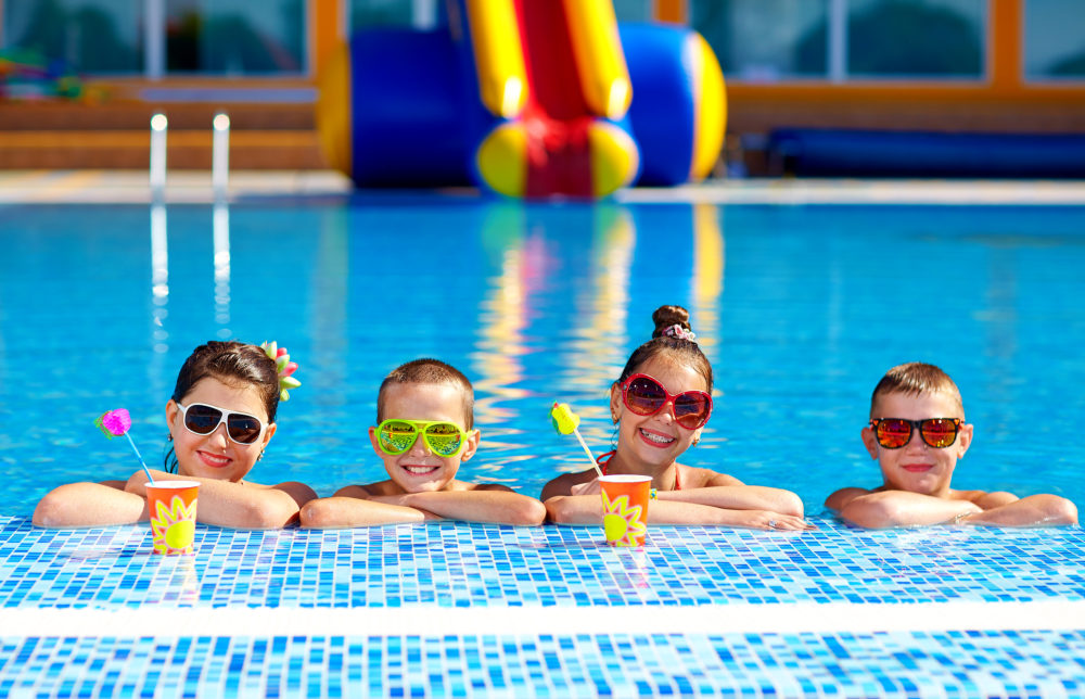 group of happy teenage kids in the pool